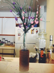 A cute DIY project using a wine bottle, twine and branches with spring bulbs